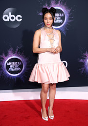 Constance Wu looked foxy in a pale pink Prada dress with a plunging lace-up neckline and a flared skirt at the 2019 American Music Awards.