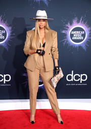 Tyra Banks styled her suit with on-trend PVC pumps.