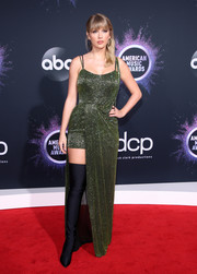 Taylor Swift chose a green Julien Macdonald dress with a high-low hem and all-over beading for the 2019 American Music Awards.