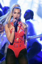 Dua Lipa went the bondage-chic route in a strappy red bodysuit by Versace for her performance at the 2019 American Music Awards.