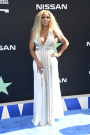 Mary J. Blige looked divine in a plunging white Alberta Ferretti gown with a beaded front at the 2019 BET Awards.