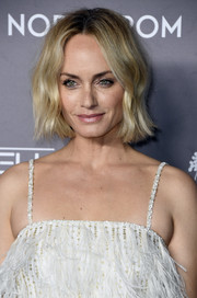 Amber Valletta sported a short wavy hairstyle at the 2019 Baby2Baby Gala.