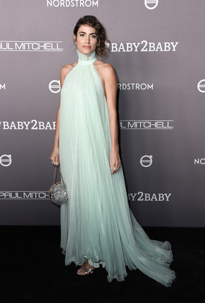 Nikki Reed polished off her look with a crystal orb purse by Marzook.