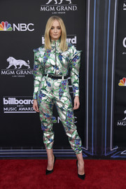 Sophie Turner was futuristic-chic in a metallic jacquard jacket and pants combo by Louis Vuitton at the 2019 Billboard Music Awards.