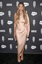 Chrissy Teigen looked divine in a nude one-shoulder dress by Ralph & Russo at the 2019 Brandweek Brand Genius Awards.