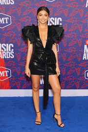 Sarah Hyland showed plenty of skin in a plunging black sequin dress by Redemption at the 2019 CMT Music Awards.