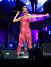 Katy Perry performed at Coachella 2019 wearing a red cutout jumpsuit with a crystal net overlay.