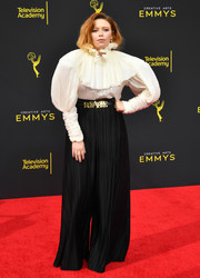 Natasha Lyonne was Victorian-chic in a white Rodarte blouse with a ruffled collar and leg-o'-mutton sleeves at the 2019 Creative Arts Emmy Awards.