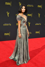 Diane Guerrero gleamed in a gold off-the-shoulder cutout gown by J. Mendel at the 2019 Creative Arts Emmy Awards.