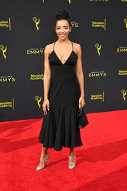 Tinashe attended the 2019 Creative Arts Emmy Awards wearing a black slip dress with a flared hem.