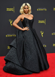 Laverne Cox stole the spotlight in a structured strapless ballgown by Zac Posen at the 2019 Creative Arts Emmy Awards.