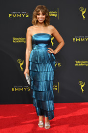 Amber Stevens West shimmered in a strapless metallic-blue dress with a tiered, pleated skirt at the 2019 Creative Arts Emmy Awards.