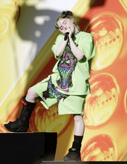Billie Eilish completed her funky look with a pair of long shorts.