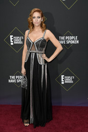 Brittany Snow coordinated her dress with a silver cage purse by Marzook.