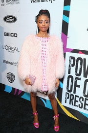 Skai Jackson styled her outfit with a pair of hot-pink sandals.