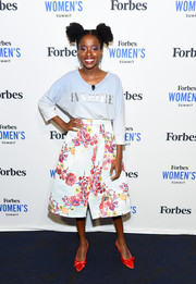 Amanda Gorman was casual up top in a loose blue 'Inspire' sweatshirt at the 2019 Forbes Women's Summit.