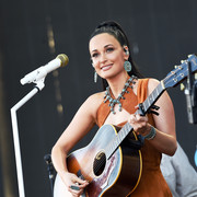 Kacey Musgraves styled her suede outfit with a statement turquoise necklace for her Coachella look.