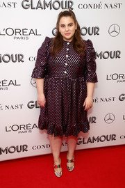 Beanie Feldstein completed her outfit with silver broad-strap pumps.