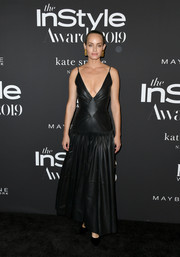 Amber Valletta took a daring plunge in this black leather gown by Loewe at the 2019 InStyle Awards.