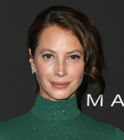 Christy Turlington Burns went for an elegant loose bun with wavy tendrils at the 2019 InStyle Awards.