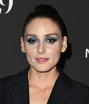 Olivia Palermo went for a bold beauty look with a heavy application of blue eyeshadow.