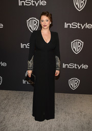 Rachel Bloom cut an elegant figure in a black Alexander McQueen column dress with beaded sleeves at the InStyle and Warner Bros. Golden Globes after-party.