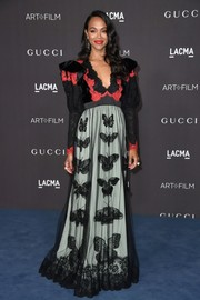 Zoe Saldana chose a color-block butterfly-motif lace gown by Gucci for the 2019 LACMA Art + Film Gala.