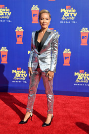 Jada Pinkett Smith glowed on the red carpet in a silver pantsuit by Dsquared2 at the 2019 MTV Movie and TV Awards.