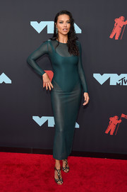 Adriana Lima styled her dress with metallic T-strap sandals by Christian Louboutin.