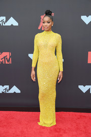 Keke Palmer cut a svelte silhouette in this yellow column dress by Yousef Al Jasmi at the 2019 MTV VMAs.