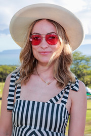 Olivia Wilde kept the sun out with a cream wide-brimmed hat at the 2019 Maui Film Festival.