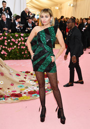 Miley Cyrus worked a structured black and emerald-green mini dress by Saint Laurent at the 2019 Met Gala.
