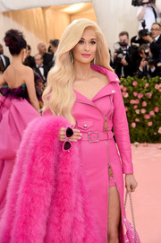Kacey Musgraves matched pink cateye sunnies with a leather dress and a fur stole, all by Moschino, for the 2019 Met Gala.
