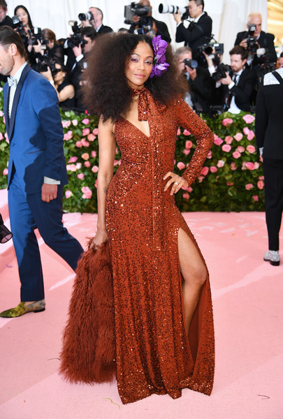 Zoe Saldana was disco-ready in a rust sequined gown by Michael Kors at the 2019 Met Gala.