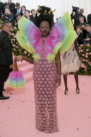 Lupita Nyong'o was a rainbow-colored butterfly in this Versace number at the 2019 Met Gala.