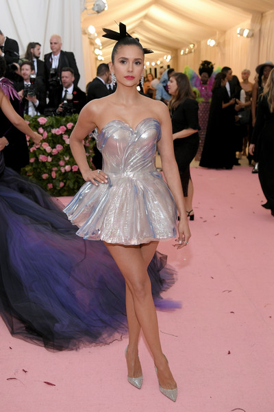 Nina Dobrev looked like a fairy in this strapless silver mini dress by Zac Posen at the 2019 Met Gala.