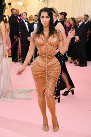 Kim Kardashian was dripping with crystals in this wet-look dress by Mugler at the 2019 Met Gala.