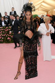 Joan Smalls went for tribal glamour in a sheer black cutout gown by Prabal Gurung at the 2019 Met Gala.