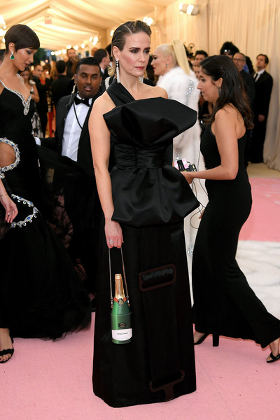 Sarah Paulson went for playful styling with a champagne bottle purse.