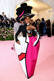 Janelle Monae put on an eye-popping display in this Picasso-inspired, androgynous-glam gown by Christian Siriano at the 2019 Met Gala.