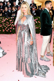 Kate Moss lit up the 2019 Met Gala with this fully sequined, cape-detail gown by Marc Jacobs.