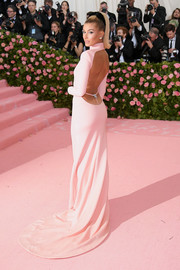 Hailey Bieber was a knockout in a backless pink gown by Alexander Wang at the 2019 Met Gala.