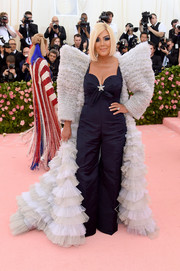Kris Jenner donned a navy Tommy Hilfiger jumpsuit with a star-embellished sweetheart neckline for the 2019 Met Gala.