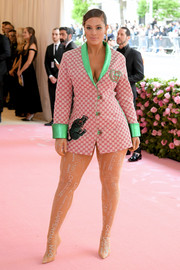 Ashley Graham rocked a custom Gucci x Dapper Dan blazer, in pink with green cuffs and lapels, at the 2019 Met Gala.