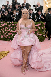 Nicki Minaj was a sexy princess in a crystal-embellished pink dress with an ultra-long train at the 2019 Met Gala.