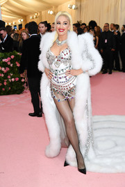 Gwen Stefani hit the 2019 Met Gala wearing a gemstone-encrusted bodysuit by Moschino.