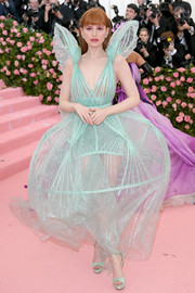 Madelaine Petsch paired her dress with matching platforms by Jimmy Choo.