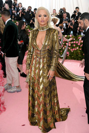 Rita Ora was sexy-glam in a cleavage-baring gold sequined gown by Marc Jacobs at the 2019 Met Gala.