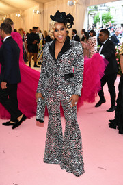 Tiffany Haddish channeled the groovy '70s in a zebra-patterned bell-bottom pantsuit by Michael Kors at the 2019 Met Gala.
