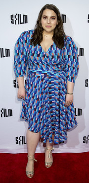 Beanie Feldstein styled her frock with strappy gold ankle-tie sandals.